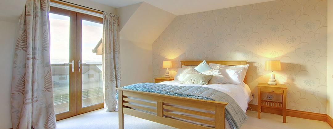 "The beautifully decorated master bedroom has a king size bed, an ensuite shower room, a 32"" flat screen TV with Freeview and a balcony from which to enjoy the fantastic views to the Mull of Galloway."